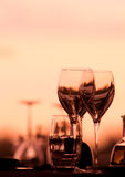 Wine Glasses. Romantic Glasses set in a romantic restaurant setting Stock Images