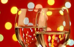 Wine glasses in a romantic setting royalty free stock photos