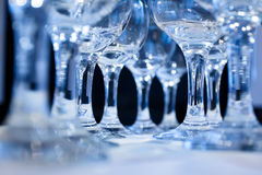 Wine glasses in row on the wedding table Royalty Free Stock Image