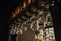 Wine glasses in shelf above a bar rack in restaurant Royalty Free Stock Photography