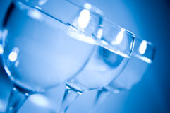 Wine glasses silhouetted. Shallow DOF Royalty Free Stock Photography
