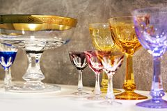Glasses for alcoholic drinks. Wine glasses and small glasses for alcoholic drinks Royalty Free Stock Photography
