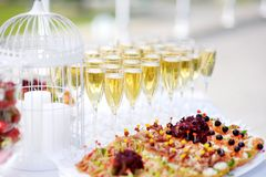 Wine glasses during some festive event Royalty Free Stock Photos