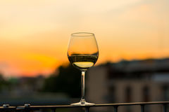 Wine in glasses with sunset background. Wine in glasses with the sunset background royalty free stock photo