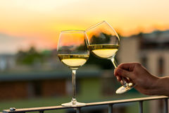 Wine in glasses with sunset background. Wine in glasses with the sunset background stock photos