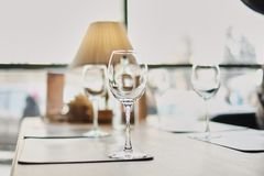 Wine glasses on table. Many glasses ready to serve drinks at a party. Business dinner royalty free stock image