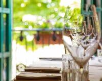 Wine Glasses on Table Near Window stock photo