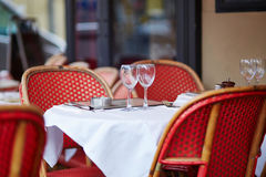 Wine glasses on a table of Parisian outdoor cafe Royalty Free Stock Images