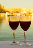 Wine glasses on the table with sea background Royalty Free Stock Photo