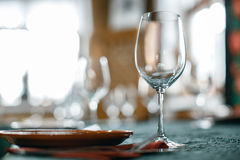 Wine glasses and table serving in rustic style restaurant Stock Images