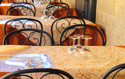 Wine glasses on the tables of street cafes Royalty Free Stock Photography