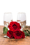 Wine glasses and three red roses Stock Photo