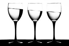 Wine glasses on a tilt Royalty Free Stock Photos