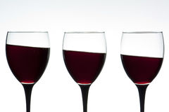 Wine glasses on a tilt Stock Images