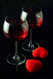 Wine glasses and a two hearts Stock Photography