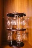 Wine glasses upside down. Glasses hanging upsidedown in wine bar interior Stock Photos