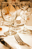 Wine glasses in warm lighting stock images