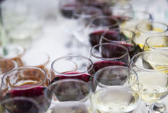 Wine glasses with white and red wine on the table on a blurred stock images