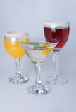 Wine glasses with wine and orange juice Stock Image