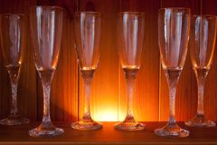 Wine glasses on a wooden shelf Royalty Free Stock Photography