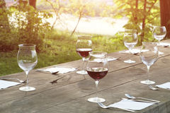 Wine glasses on a wooden table Royalty Free Stock Photography