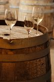 Wine glassess on an old wine barrel Stock Photography