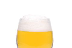 A wine goblet of beer close-up. Are located on the white background Royalty Free Stock Photos