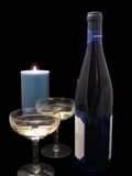 Wine, goblets, and candle Stock Photos