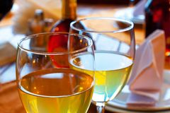 Wine goblets on restaurant table Royalty Free Stock Images