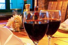Wine goblets on restaurant table Royalty Free Stock Image