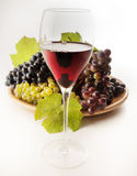 Wine. A good glass of wine with grape Royalty Free Stock Photography