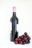 Wine and grape. A bottle of wine with grape Royalty Free Stock Photos