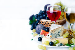 Wine, Grape And Cheese Over White Stock Photos