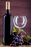 Wine and grape on a background of a canvas Stock Images