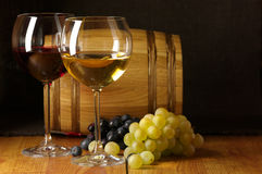 Wine, grape and barrel Stock Photos