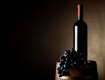 Wine and grape on a barrel Royalty Free Stock Images