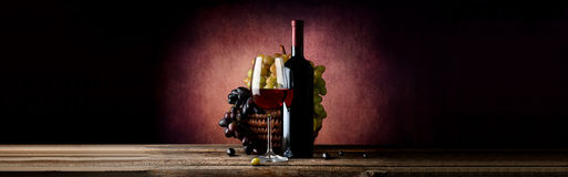 Wine with grape in basket Stock Photos