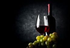 Wine with grape on black Stock Image