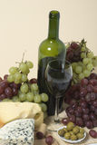 Wine, grape and cheese. Wine bottle glass grape olive and cheese Royalty Free Stock Photos