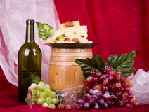 Wine, grape, cheese and barrel Royalty Free Stock Image