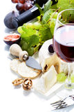Wine, grape and cheese Stock Photography