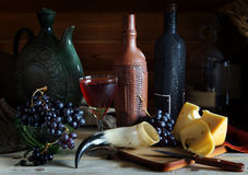 Wine, grape and cheese on wooden table. Still life with wine, grape and cheese on wooden table Royalty Free Stock Photos