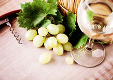 Wine, Grape and Grapevine with Green Leaves. Wine, Glass, Grape and Grapevine with Green Leaves on Rustic Wooden Board Background stock photography