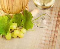 Wine, Grape and Grapevine with Green Leaves. On Rustic Wooden Board Background stock image