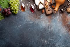 Wine, grape and cheese stock images