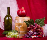 Wine, grape, pomegranate and barrel Royalty Free Stock Image