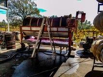 Wine grape press machine stock photography