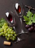 Wine and grape. Vintage corkscrew. Top view stock images