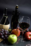 Wine and Grapes. An autumn display of wine and grapes. Harvest time Royalty Free Stock Photos