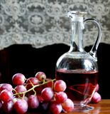 Wine and grapes. Still life with grapes and wine flagon Royalty Free Stock Photo